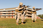 October 22, 2014. Camp LeJeune, North Carolina.<br /> Cpl. Raquel Mathieu, center, aims a M4 rifle during patrol training for the 3rd Platoon of the Ground Combat Element Integrated Task Force. Marines in 3rd Platoon of the GCEITF are all considered provisional infantrymen as they have not been to the School of Infantry (SOI) previous to volunteering for the GCEITF.<br />  The Ground Combat Element Integrated Task Force is a battalion level unit created in an effort to assess Marines in a series of physical and medical tests to establish baseline standards as the Corps analyze the best way to possibly integrate female Marines into combat arms occupational specialities, such as infantry personnel, for which they were previously not eligible. The unit will be comprised of approx. 650 Marines in total, with about 400 of those being volunteers, both male and female. <br />  Jeremy M. Lange for the Wall Street Journal<br /> COED