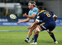 Waratahs Michael Hooper, left, gets the ball away against the Highlanders in the Super 15 rugby match, Forsyth Barr Stadium, Dunedin, New Zealand, Saturday, March 14, 2015. Credit: SNPA/Dianne Manson