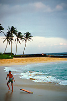 boy with boogie board at Poipu beach, Kauai