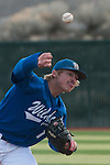 Western Nevada Wildcats' Conor Harber (11) throws a pitch in the first inning against  the Salt Lake Community College Bruins at WNC on Sunday, March 2, 2014. The Bruins won game 1 of a double-header against the Wildcats in double overtime 9-4.<br /> (Photo by Kevin Clifford)