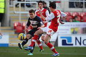Luke Freeman of Stevenage shoots past Jamie Devitt of Rotherham. Rotherham United v Stevenage - FA Cup 1st Round - New York Stadium, Rotherham - 3rd November 2012. © Kevin Coleman 2012.