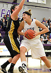 SIOUX FALLS, SD - DECEMBER 6:  Sam Knecht #50 from the University of Sioux Falls drives against Millie Niggeling #40 from Wayne State in the first half of their game Friday night at the Stewart Center. (Photo by Dave Eggen/Inertia)
