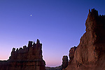 Crescent moon at dawn over Hoodoos Navajo Loop Trail, Bryce Canyon National Park, UTAH