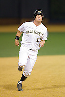 Joe Napolitano (12) of the Wake Forest Demon Deacons hustles towards third base against the High Point Panthers at Wake Forest Baseball Park on April 2, 2014 in Winston-Salem, North Carolina.  The Demon Deacons defeated the Panthers 10-6.  (Brian Westerholt/Four Seam Images)
