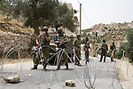 IDF soldiers at a road block enforce a closed military zone in Beit Jala, near bethlehem, on Sunday May 16th 2010. The IDF designated the area a closed military zone following a demonstration in which eight activists were arrested.