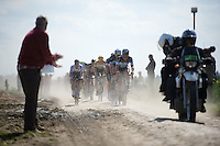 Team Ettix-Quickstep takes to the front and sets the pace in sector 14: Tilloy à Sars-et-Rosières (2.4km), in pursuit of the race leaders<br /> <br /> 113th Paris-Roubaix 2015