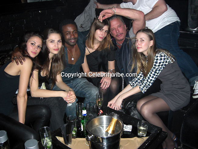 **EXCLUSIVE**.Mickey Rourke kissing Model Eugenia from Serbia  who was introduced by Kiki Cornille owner of Bijoux Longue..Mickey was nominated for an OSCAR in 2009 for Best Actor and is currently shooting Iron Man 2 Movie in Los Angeles, CA, where he is leaving in a 90,000 Dollars monthly rental Mansion..Bijoux Lounge..New York, NY, USA..Friday, May 08, 2009. .Photo By Celebrityvibe.com.To license this image please call (212) 410 5354; or Email: celebrityvibe@gmail.com ;.website: www.celebrityvibe.com