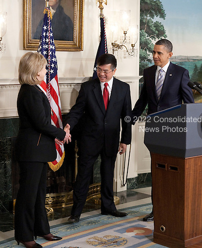 Gary Locke, United States secretary of commerce, shakes hands with Hillary Rodham Clinton, U.S. secretary of state, after his nomination to be the next U.S. ambassador to China, was made by U.S. President Barack Obama at the White House in Washington, D.C., U.S., on Wednesday, March 9, 2011. If confirmed by the Senate, Locke would take over the diplomatic mission in a country that is a linchpin in Obama's trade policy. .Credit: Joshua Roberts / Pool via CNP