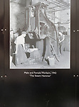 Public display of old historic images about the GWR works, Swindon, Wiltshire, England, UK male and female workers 1942 The Steam hammer