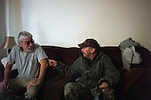 Los Angeles, California<br /> February 1, 2014<br /> <br /> Former homeless Navy veteran 52 year old Raymond McGinnis (right) with his veteran, drinking buddy and former homeless friend Ray. Both had been homeless for many years. McGinnis served from 1977 to 1983 and was working as a landscaper when he was hit by a car and permanently injured his leg and subsequently lost his job. He has been in his HUD VASH house of about 1 and a half years.