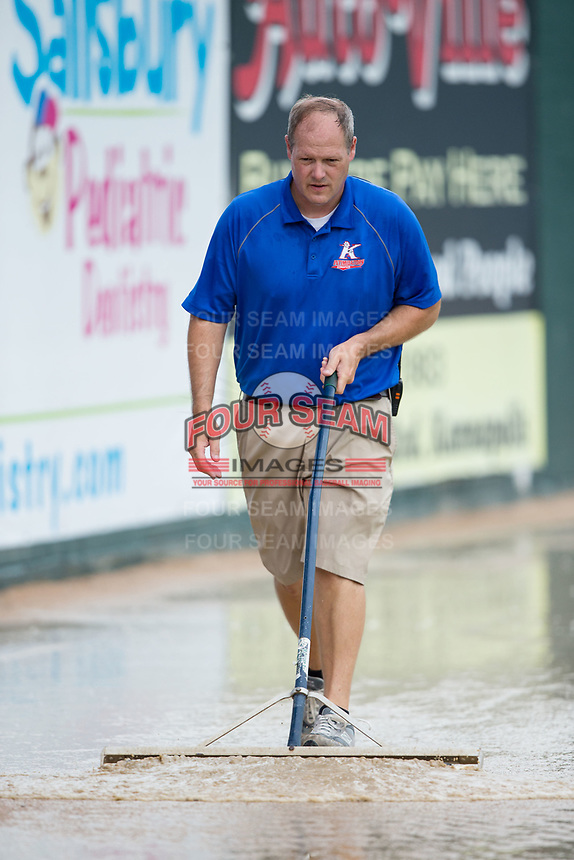 Kannapolis Intimidators General Manager Randy Long pushes water off the warning track prior to the game against the West Virginia Power at Kannapolis Intimidators Stadium on June 17, 2017 in Kannapolis, North Carolina.  The Power defeated the Intimidators 6-1.  (Brian Westerholt/Four Seam Images)