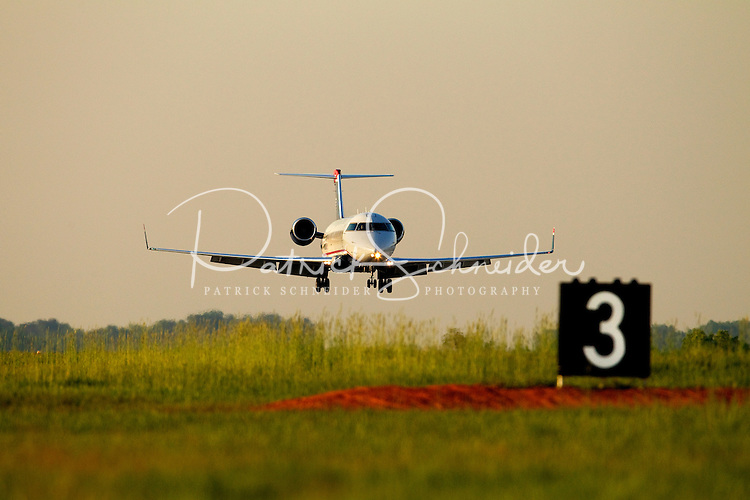 A line of planes make their descent at Charlotte-Douglas International Airport in Charlotte, North Carolina. Charlotte-based photographer has other images of transportation, airplanes on runways (and taking off and landing) and interior/exterior airport images of Charlotte-Douglas Intl Airport in portfolio.
