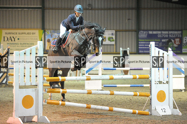 Class 4. British showjumping juniors. Area 40 Christmas show. Brook Farm training centre. Essex. UK. 25/11/2017. ~ MANDATORY CREDIT Garry Bowden/Sport in Pictures - NO UNAUTHORISED USE - +44 7837 394578