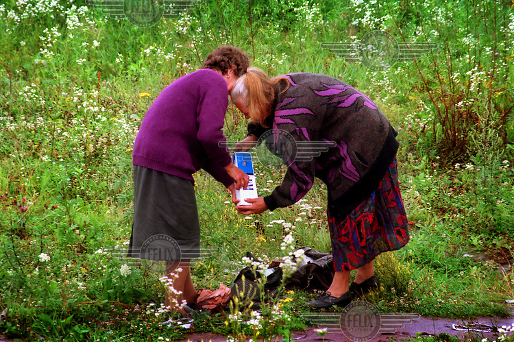 After smuggling cigarettes across the border from Ukraine in their clothes, two women place the packets into cartons to be sold in Przemysl.