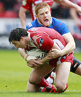 PICTURE BY CHRIS MANGNALL /SWPIX.COM...Rugby League - Super League  - Salford City Reds v Hull Kingston Rovers - Salford City Stadium , Eccles, England  - 09/04/12...Salford's Matty Smith  tackled by  Hull's Kris Welham