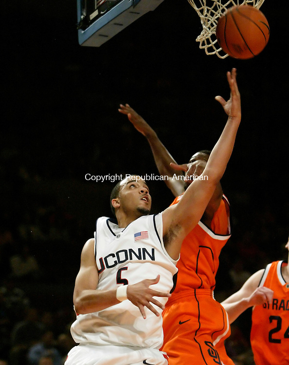 NEW YORK, NY--09 MARCH 2006- 030906JS13-<br /> UConn's Marcus Williams puts up a shot over Syracuse's Demetris Nichols during their 86-84 overtime loss to Syracuse in the Big East Tournament Thursday at Madison Square Garden in New York City. Williams finished with 17 points.<br />  --Jim Shannon Republican American--UConn; Syracuse; Demetris Nichols; Marcus Williams are CQ
