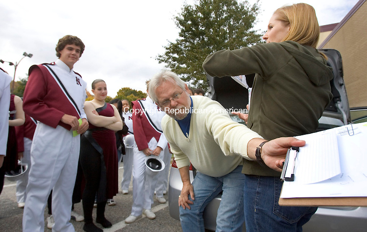 NAUGATUCK, CT. 24 October 2010-102410SV02--Bob Kogut, band director and Sandy Lee asst. director, of the Naugatuck High School marching band gives band members and parents their marching orders as the head out for donations in Naugatuck Sunday. The band needs to raise between $5000 and $8000 after the annual Thunder in the Valley was canceled earlier this month.<br /> Steven Valenti Republican-American