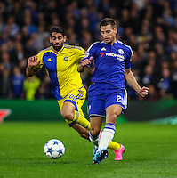 Cesar Azpilicueta of Chelsea (right) and Omri Ben Harush of Maccabi Tel-Aviv during the UEFA Champions League match between Chelsea and Maccabi Tel Aviv at Stamford Bridge, London, England on 16 September 2015. Photo by David Horn.