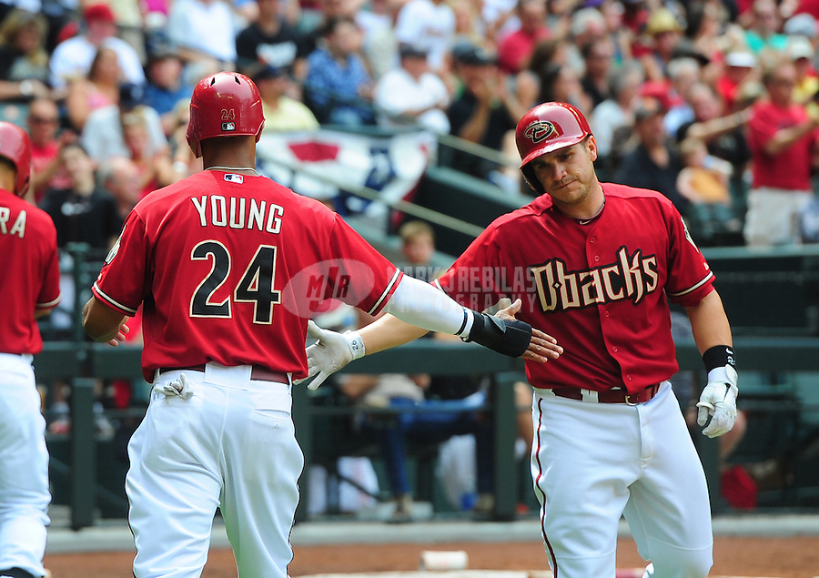 Apr. 8, 2012; Phoenix, AZ, USA; Arizona Diamondbacks Chris Young (24) is congratulated by catcher Miguel Montero after scoring in the fourth inning against the San Francisco Giants at Chase Field. Mandatory Credit: Mark J. Rebilas-