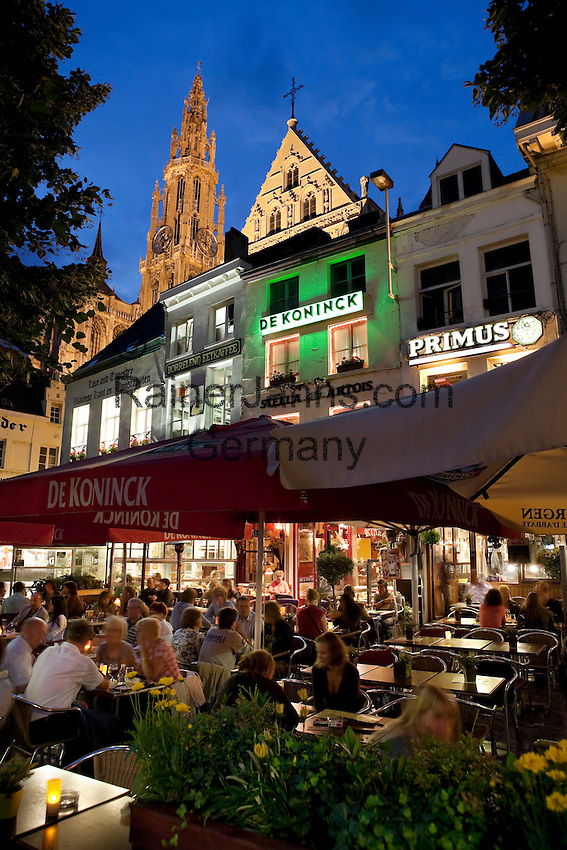 Belgium, Antwerp: Evening cafe scene in Groenplats with the Cathedral behind