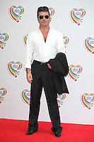 Simon Cowell arriving for the Health Lottery Tea Party, The Savoy, London. 02/06/2014 Picture by: Alexandra Glen / Featureflash