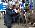 First Minister Alex Salmond gets a kiss from German Short-Haired pointer Hector who was brought along by owner Cally Wight, 50, whilst touring Turriff