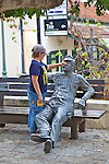Boy Playing With Statue