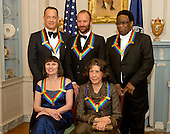 The five recipients of the 2014 Kennedy Center Honors pose for a group photo following a dinner hosted by United States Secretary of State John F. Kerry at the U.S. Department of State in Washington, D.C. on Saturday, December 6, 2014.  The 2014 honorees are: actor and filmmaker Tom Hanks, top left; singer-songwriter Sting, top center; singer Al Green, top right; ballerina Patricia McBride, bottom left;  and comedienne Lily Tomlin, bottom right.<br /> Credit: Ron Sachs / Pool via CNP