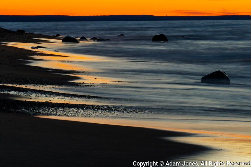 Lake Superior shoreline at sunset, Pictured Rocks National Lakeshore, Upper Peninsula of Michigan.