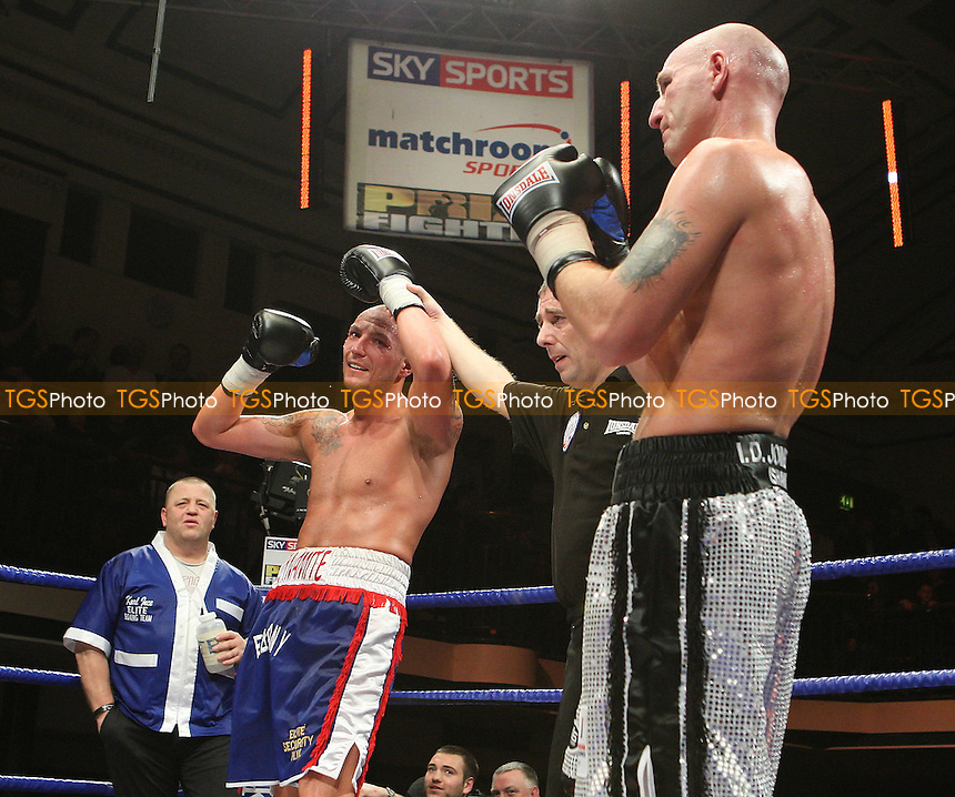 Controversy as a mistake is made with the Semi-Final result between Darren Stubbs and Cark Dilks. Dilks (L) is declared the victor but Stubbs subsequently finds out that he is the winner - Prizefighter 'The Light Heavyweights' boxing tournament at York Hall, Bethnal Green, promoted by Matchroom Sports / Barry Hearn - 21/02/09 - MANDATORY CREDIT: Gavin Ellis/TGSPHOTO - Self billing applies where appropriate - 0845 094 6026 - contact@tgsphoto.co.uk - NO UNPAID USE.
