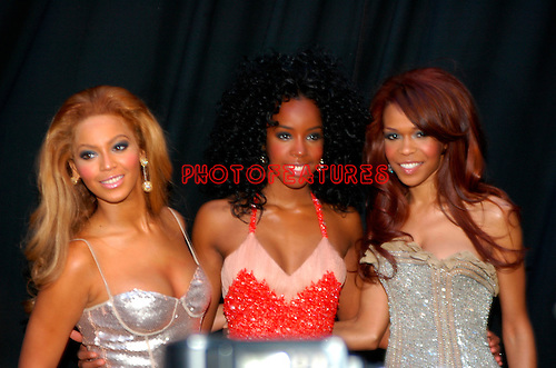 Destiny's Child - Beyonce Knowles, Kelly Rowland and Cheryl Hines.at the 2004 Radio Music Awards at the Aladdin Hotel in Las Vegas, October 25th,2004.