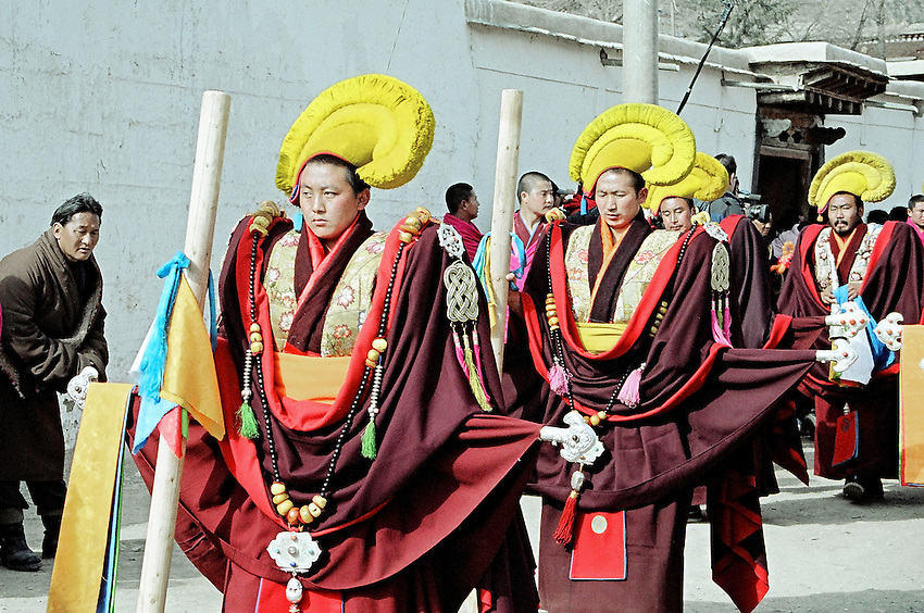 The assistants of the Master of Discipline are opening the way for the leader of the ceremonies for Monlam Chenmo (the Great Prayer)  in the monastery of Labrang. Xiahe, China, February, 22, 2007