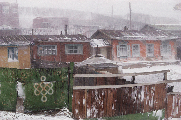 A fierce September snowstorm whips through a residential hillside area of Ulaanbaatar, Mongolia. Material World Project.