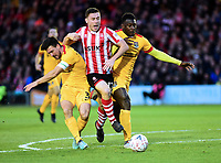 Lincoln City's Shay McCartan gets between Northampton Town's David Buchanan, left and Hakeem Odoffin<br /> <br /> Photographer Andrew Vaughan/CameraSport<br /> <br /> Emirates FA Cup First Round - Lincoln City v Northampton Town - Saturday 10th November 2018 - Sincil Bank - Lincoln<br />  <br /> World Copyright © 2018 CameraSport. All rights reserved. 43 Linden Ave. Countesthorpe. Leicester. England. LE8 5PG - Tel: +44 (0) 116 277 4147 - admin@camerasport.com - www.camerasport.com