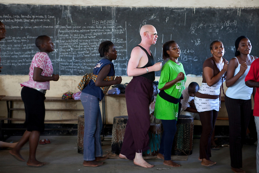 June 28, 2010 - Dar Es Salaam, Tanzania - Albinos and relatives performs during a theater practice in preparation for an upcoming show organized by the Tanzania Albino Society Kinondoni District in order to spread awarness on albinos issues in Tanzania. Tanzania is believed to have Africa' s largest population of albinos, a genetic condition caused by a lack of melanin in the skin, eyes and hair and has an incidence seven times higher than elsewhere in the world. Over the last three years people with albinism have been threatened by an alarming increase in the criminal trade of Albino body parts. At least 53 albinos have been killed since 2007, some as young as six months old. Many more have been attacked with machetes and their limbs stolen while they are still alive. Witch doctors tell their clients that the body parts will bring them luck in love, life and business. The belief that albino body parts have magical powers has driven thousands of Africa's albinos into hiding, fearful of losing their lives and limbs to unscrupulous dealers who can make up to US$75,000 selling a complete dismembered set. The killings have now spread to neighboring countries, like Kenya, Uganda and Burundi and an international market for albino body parts has been rumored to reach as far as West Africa. Photo credit: Benedicte Desrus