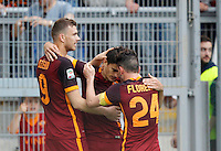 Calcio, Serie A: Lazio vs Roma. Roma, stadio Olimpico, 3 aprile 2016.<br /> Roma's Diego Perotti, center, celebrates with teammates Edin Dzeko, left, and Alessandro Florenzi after scoring during the Italian Serie A football match between Lazio and Roma at Rome's Olympic stadium, 3 April 2016.<br /> UPDATE IMAGES PRESS/Riccardo De Luca