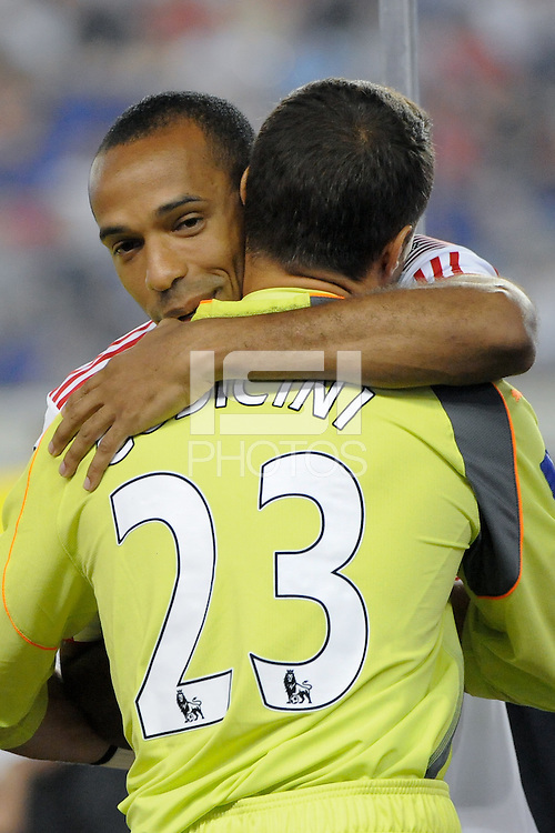Thierry Henry (14) of the New York Red Bulls hugs Tottenham Hotspur F. C. goalkeeper Carlo Cudicini (23) before the match. Tottenham Hotspur F. C. defeated the New York Red Bulls 2-1 during a Barclays New York Challenge match at Red Bull Arena in Harrison, NJ, on July 22, 2010.