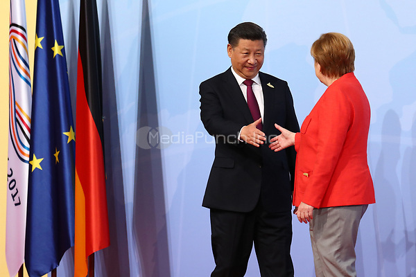 German chancellor Angela Merkel greets the Chinese president Xi Jinping at the G20 summit in Hamburg, Germany, 7 July 2017. The heads of the governments of the G20 group of countries are meeting in Hamburg on the 7-8 July 2017. Photo: Christian Charisius/dpa /MediaPunch ***FOR USA ONLY***