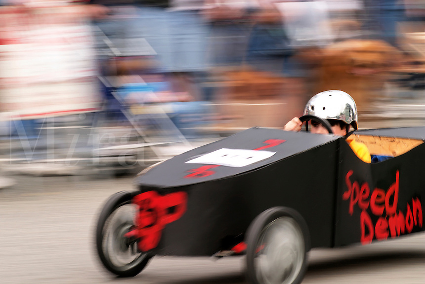 Boy competing in Soap Box Grand Prix during Kla Ha Ya Days festival, Snohomish, Snohomish County, Washington, USA