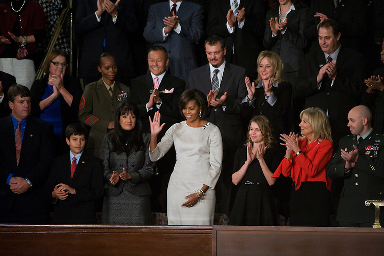 UNITED STATES - JANUARY 25:  First Lady Michelle Obama arrives in the House Chamber for President Barack Obama's State of the Union address.  Many Senators and Representatives from opposite sides of the aisle choose to sit with each other to help alleviate partisanship.  (Photo By Tom Williams/Roll Call)