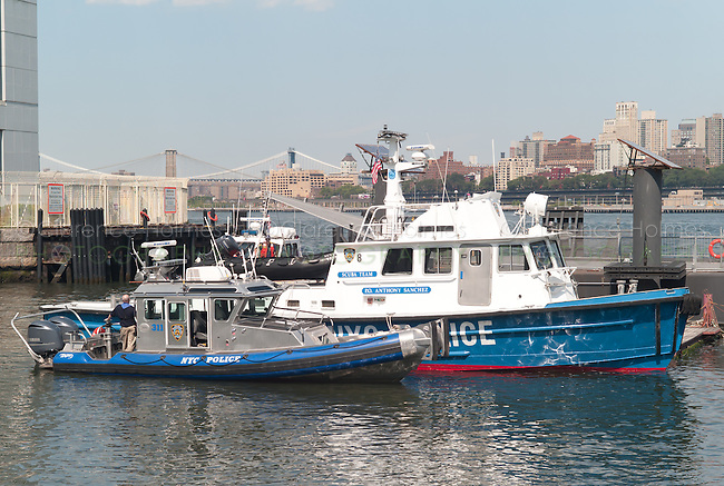 NYC Police Harbor Boat P.O. Anthony Sanchez (Scuba Diving Team) and Harbor Patrol number 311 docked off of Soissons Dock on Governors Island