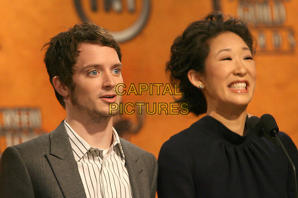 ELIJAH WOOD & SANDRA OH .13th Annual Screen Actors Guild Awards Nominations held at the Pacific Design Center, West Hollywood, California, USA..January 4th, 2007.headshot portrait smiling.CAP/ADM/ZL.©Zach Lipp/AdMedia/Capital Pictures