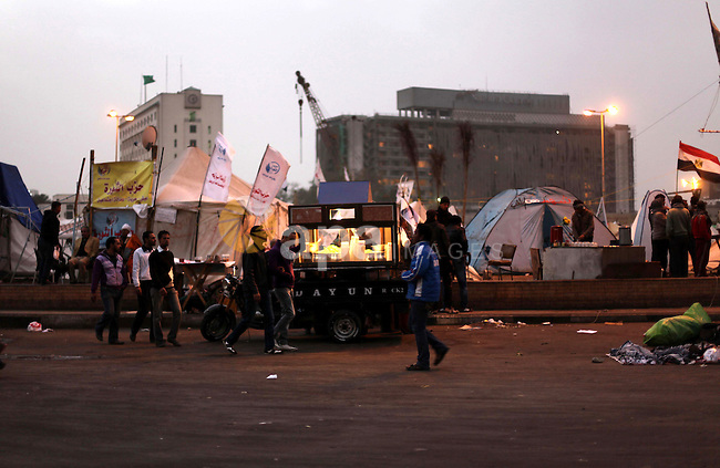 Egyptian protesters oppose President Mohamed Mursi camping at Tahrir Square in Cairo December 20, 2012. Egyptian Islamist groups are planning a mass protest in Alexandria on Friday, a move that will raise tensions a day before the final stage of a referendum on a new constitution that has split the nation. Photo by Ashraf Amra