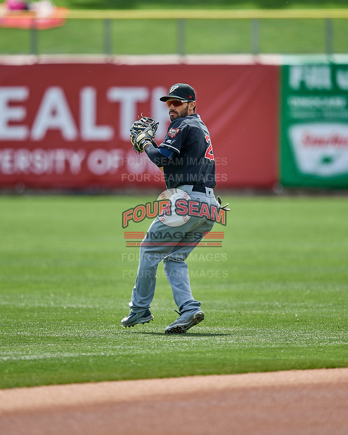 Carlos Asuaje (2) of the El Paso Chihuahuas warms up in the outfield before the game against the Salt Lake Bees in Pacific Coast League action at Smith's Ballpark on April 30, 2017 in Salt Lake City, Utah. El Paso defeated Salt Lake 3-0. This was Game 1 of a double-header. (Stephen Smith/Four Seam Images)