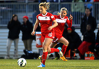 BOYDS, MARYLAND - April 06, 2013:  Caroline Miller (10) and Ingrid Wells (9) of The Washington Spirit start an attack against the University of Virginia women's soccer team in a NWSL (National Women's Soccer League) pre season exhibition game at Maryland Soccerplex in Boyds, Maryland on April 06. Virginia won 6-3.
