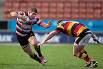 Grant Henson looks to fend off Nathan White. ITM Cup rugby game between Waikato and Counties Manukau, played at Waikato Stadium, Hamilton on Saturday 28th August 2010..Waikato won 39 - 3.