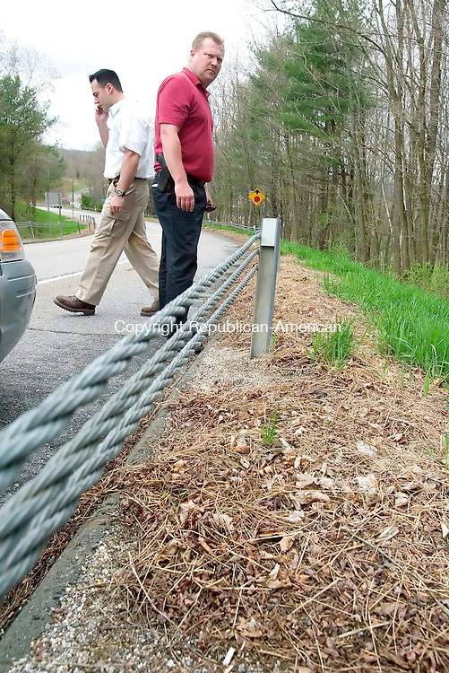 HARWINTON, CT. 03 May 2007-050307SV07--Detective Richard Baxter and Sgt. Michael Ponzillo of the Waterbury Police investigate a cold cases of three women found on Valley Road in Harwinton, exit 41 off Route 8.<br /> Steven Valenti Republican-American