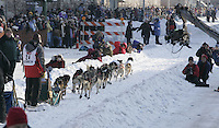 Lance Mackey leaves the Anchorage start line on 4th avenue during the start of the Iditarod.