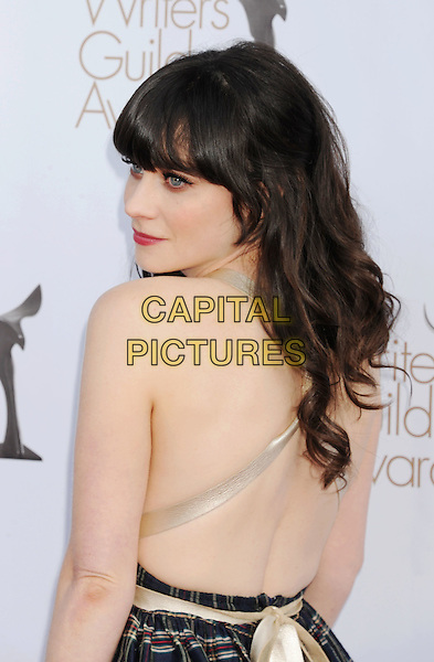 Zooey Deschanel.arriving at the 2012 Writers Guild Awards at the Hollywood Palladium in Los Angeles, California, USA, .February 19th, 2012..half length black checked dress tartan plaid back rear behind .CAP/ROT/TM.©TM/Roth Stock/Capital Pictures
