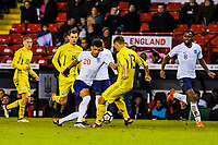 Liverpool's forward Domonic Solanke (20) for England U21's  takes on Valencia CF Mestalla's defender Ivan Zotko (13) for Ukraine U21's during the International Euro U21 Qualification match between England U21 and Ukraine U21 at Bramall Lane, Sheffield, England on 27 March 2018. Photo by Stephen Buckley / PRiME Media Images.